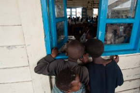 Boys looking into a schoolroom