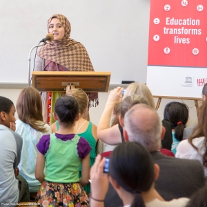 Mariam giving her speech to a class in New York