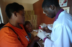 Mother getting her child checked for Malaria after his HIV test. Educated mothers are better informed about specific diseases and therefore can take measures to prevent them. ©UNICEF/Christine Nesbitt 2011