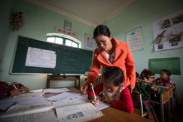 Nguyen, a teacher in Muong Khuong county, Viet Nam: 'There are 13 ethnic students in my class. All Hmong girls. Sometimes when you teach in Vietnamese they seem not to understand.'    Credit: Nguyen Thanh Tuan/UNESCO