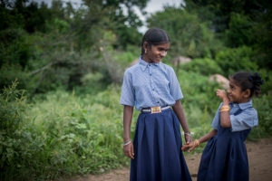 Schoolgirl Sanjitha, 14, with her cousin Ramila, 7, knows the benefits of a good quality education in India. Photo: Paloma Basi