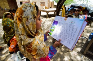 Children learning under a tree with little resources need better quality education, Pakistan. Photo: UNESCO/AMima Sayeed