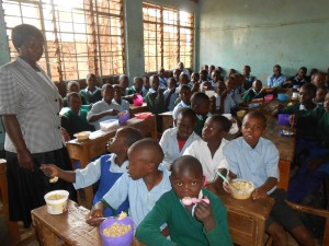Margaret in her school in the Kibera slum, where children are receiving their lunchtime meal provided by WFP.