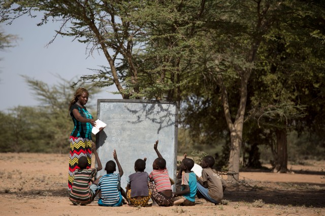Ewesit, teaching under a tree in a mobile school in Turkana, Kenya. Photo credit:UNESCO/Karel Prinsloo