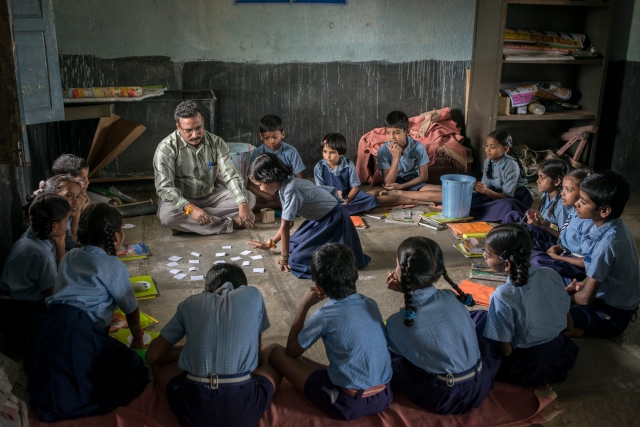 Mr. B Yadiah teaching at the Government school in Medipalli, Andhra Pradesh.