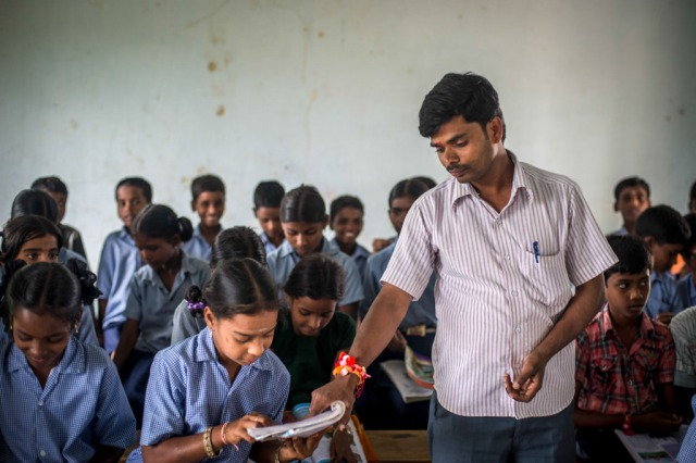 Anjaneyulu teaching at a government school in Andhra Pradesh.