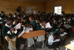 Pupils studying at Putuma JSS school, South Africa, in overcrowded classrooms with a lack of desks and chairs. . Credit: Eva-Lotta Jansson