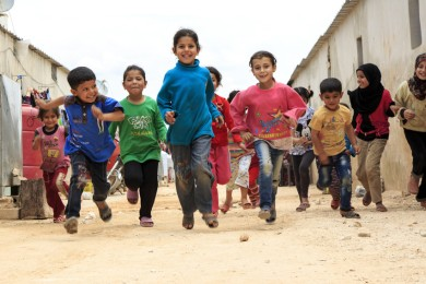 Hibaâs* seven children and her husbandâs brotherâs six children who they care for, play together in the camp for displaced people where they live in northern Syria.