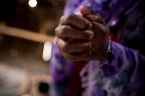 Sarah Mowlid Mohammed grips her hands tight as she tells her story at her home in the Shabelle IDP settlement in Garowe, Somalia Tuesday, July 1, 2014. Sarah was cut when she was six years old; when the wound didn't heal she was taken back to be recut. (Kate Holt/ UNICEF Photo/)